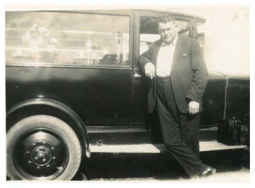 Thomas Sharkey (1871 to 1945) in 1934 with a 1926 Armstrong Siddeley Hearse